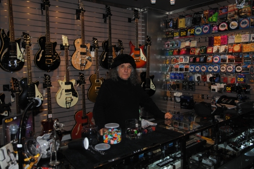 Nick Angelo and his prized Dusenberg guitars